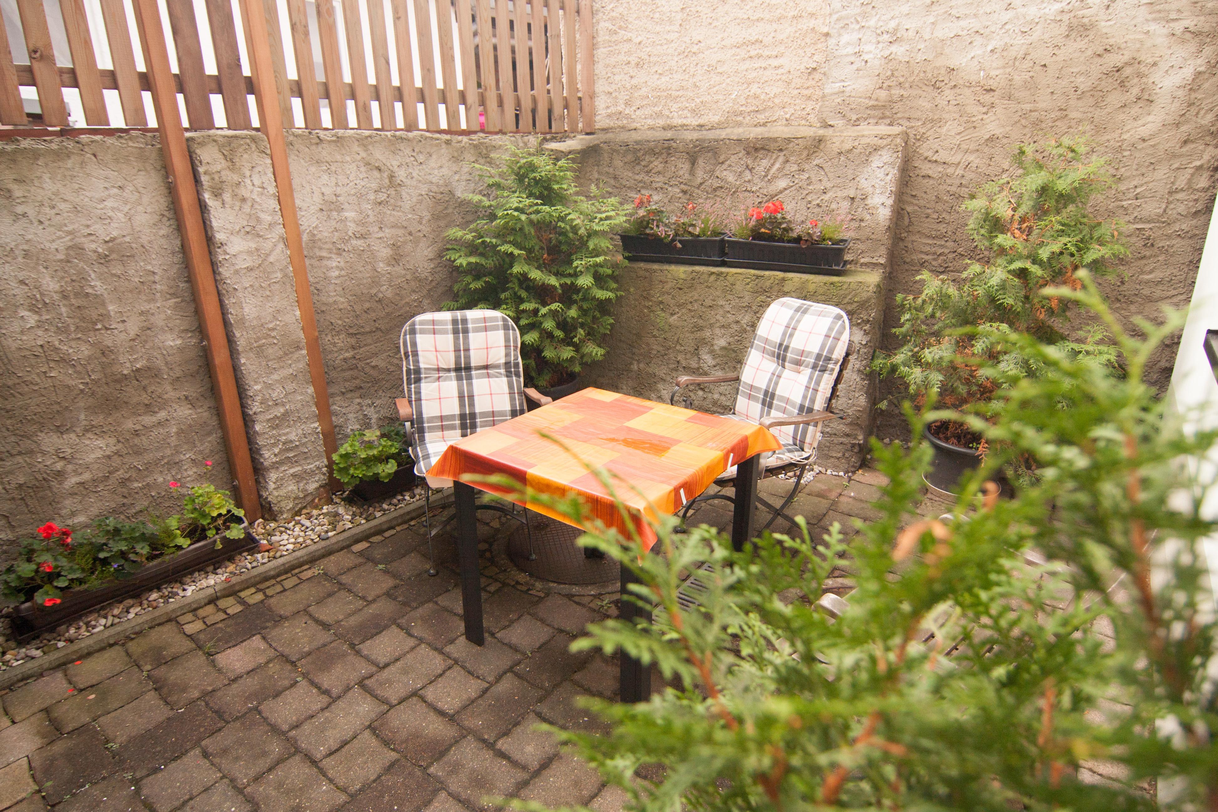 Terrasse außerhalb der Wohnung